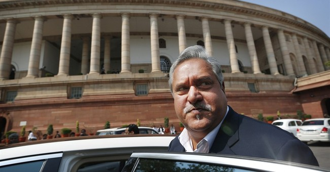 India revokes passport of tycoon who owes $1 billion