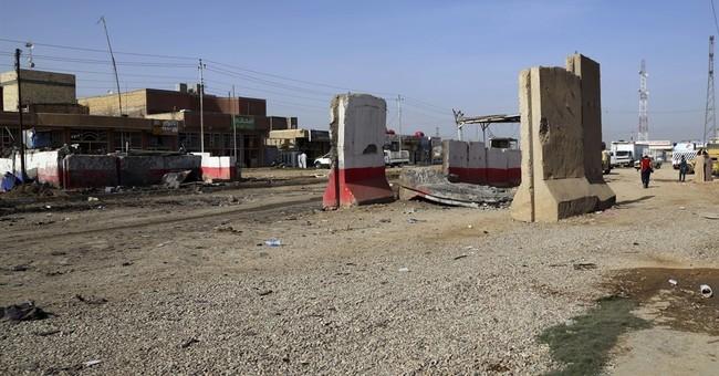 Clashes erupt between Kurdish, Shiite fighters in Iraqi town