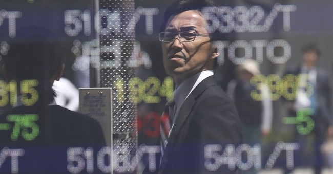 Global stocks lower as traders await central bank statements
