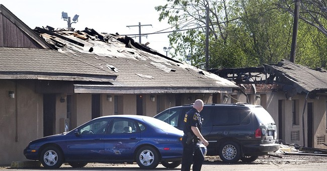 FBI agent wounded in Kansas gunfight still hospitalized
