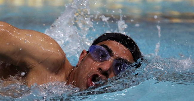 Still swimming in exile, Syrian refugee to carry Rio flame