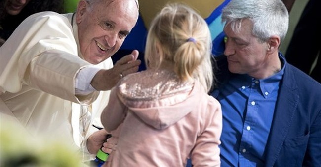 Pope makes surprise visit to Rome park marking Earth Day