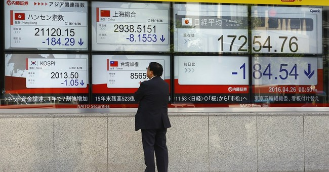 Global stocks solid ahead of central bank meetings