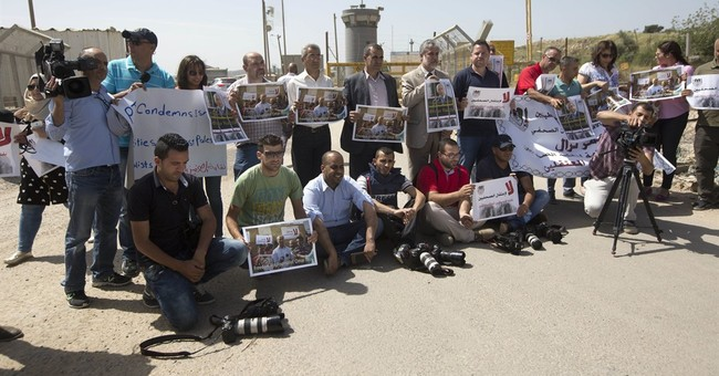 Israel silencing detained Palestinian journalist, says wife