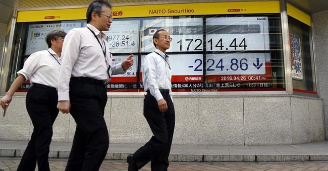 Global stocks solid ahead of central bank meetings