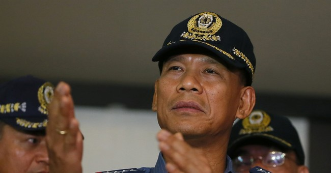 Philippine troops hunt extremists who beheaded Canadian