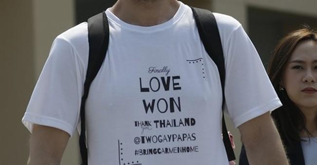 Gay couple wins custody battle against Thai surrogate mother