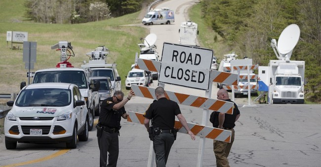 Coroner: Most Ohio victims shot many times, some bruised