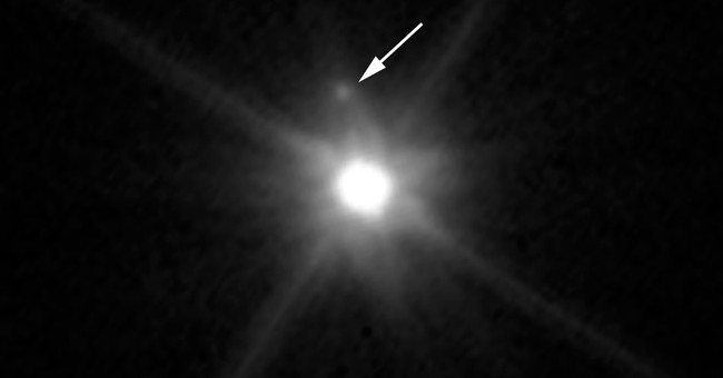Hubble Telescope finds tiny moon orbiting dwarf planet