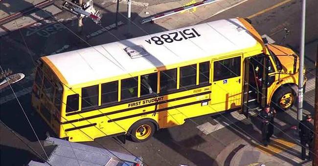 Railroad crossing arm crashes through LA school bus windows