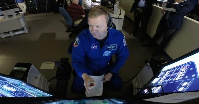 NASA astronauts prepare for flight on commercial spacecraft