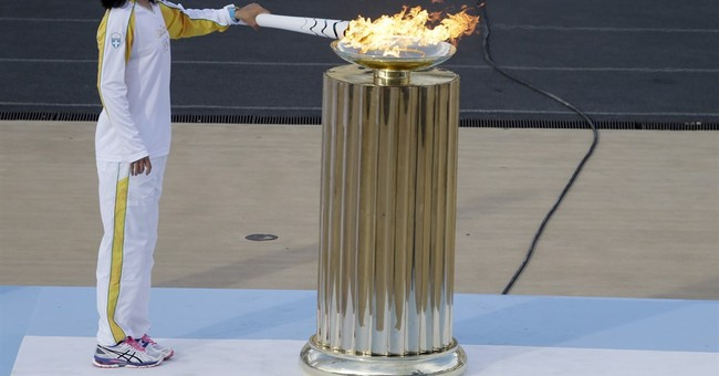 Rio gets Olympic flame 100 days before games