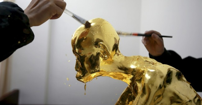 Revered Chinese monk is mummified and covered in gold leaf