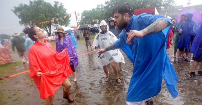 Start of 2nd weekend of Jazz Fest soaked by rain
