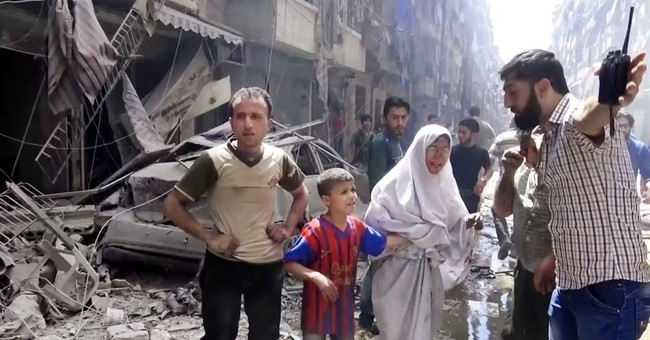 The Latest: Syrian TV: Rebels shell Aleppo mosque, kill 15