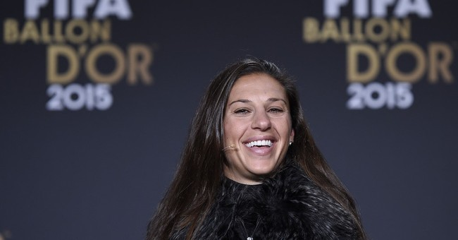 Carli Lloyd stands beside Lionel Messi as world's best