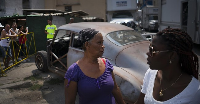 Cuba finds it hard to dampen afterglow of Obama visit