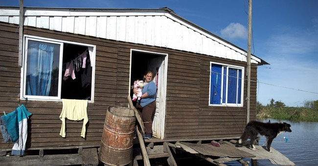 Argentina floods swamp soy crop; some must commute by boat