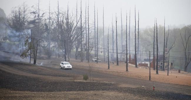 Huge fireball in gas explosion burns homes, fleeing man