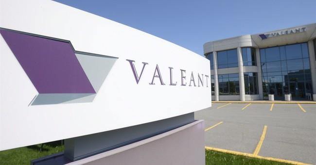 Valeant files overdue financial report, ending debt default