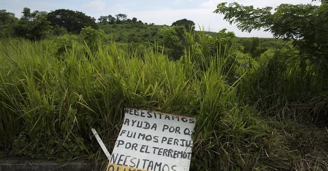 Neighbors deny rescue of quake-buried man in Ecuador