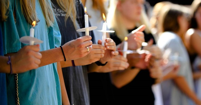 The Latest: Candles to honor car crash victims, 22 others