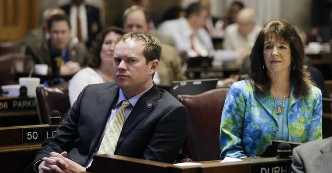 Lawmaker accused of harassment is all alone with his M&Ms