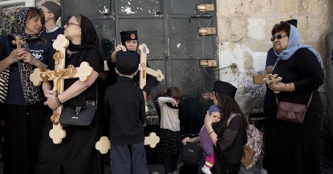 Pilgrims trace Jesus' footsteps on Good Friday in Jerusalem