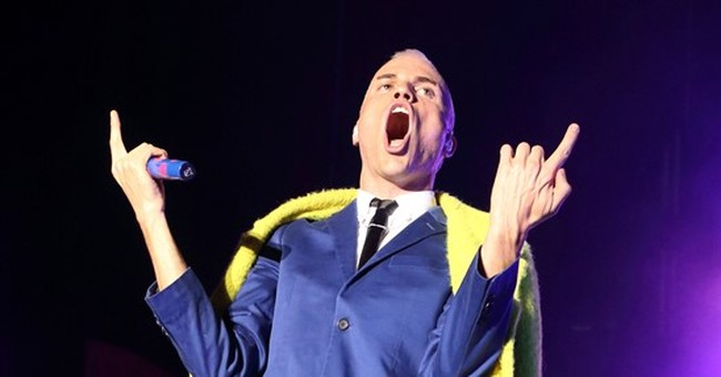 Openly gay rock singer changing tune on Mormon religion