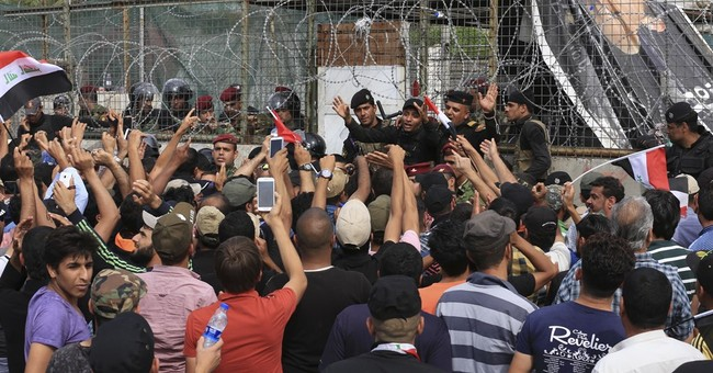 The Latest: Iraq PM says situation in Baghdad under control