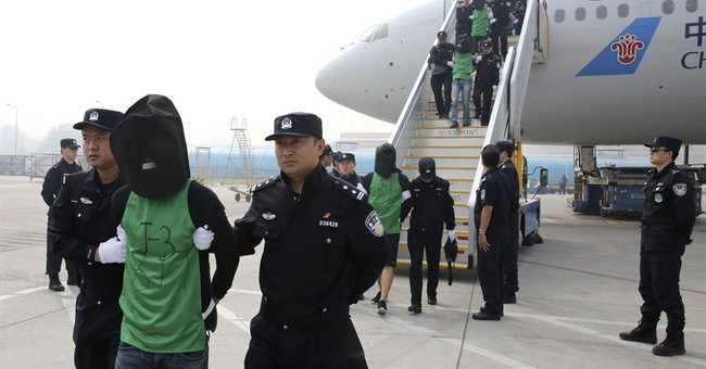 Malaysia sends 32 Taiwanese suspects to China, draws protest