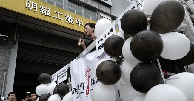 Hundreds gather in Hong Kong to protest editor's dismissal