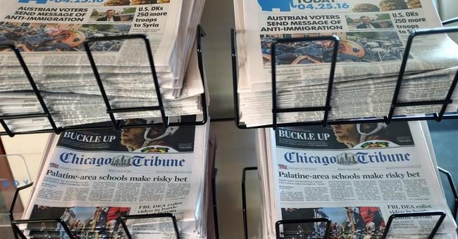 Gannett tells Tribune shareholders not to vote for board