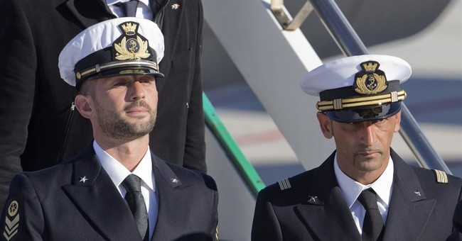 Italy: Hague tribunal OKs marine's return from India for now