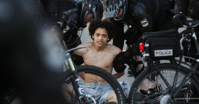 Arrests in Seattle as May Day marchers take to streets