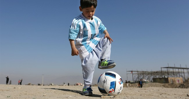 Taliban threats force Afghan boy, fan of Messi, into exile