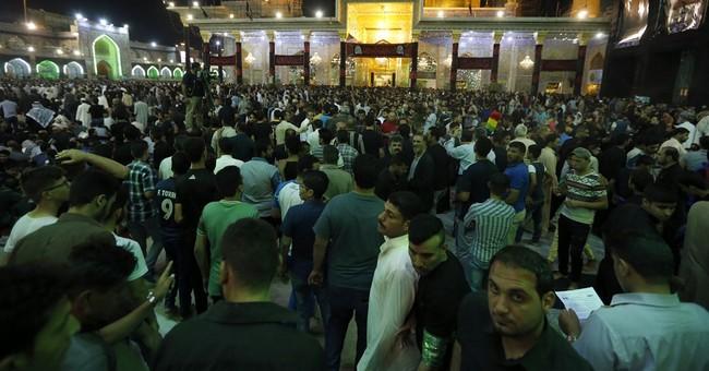Tens of thousands Shiite pilgrims converge on Baghdad shrine