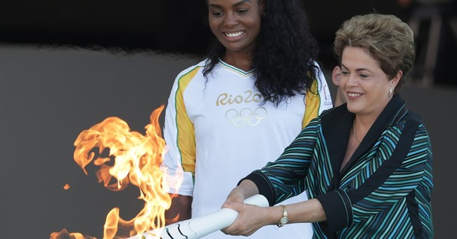 Rousseff lights Olympic flame as protesters hit the streets