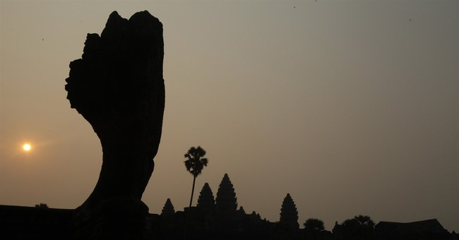 Cambodia bars cars near Angkor Wat temple to ease congestion