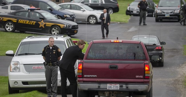 The Latest: Hopes for healing after funeral for 6 relatives