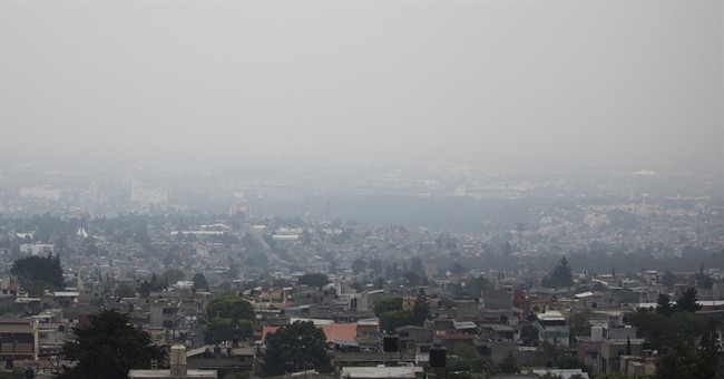 Mexico City declares 3rd day of traffic cuts over high smog