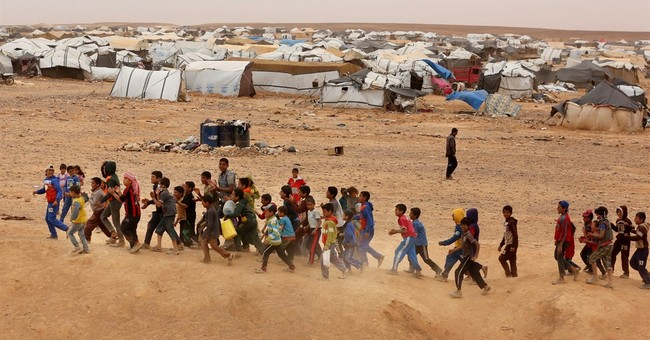 Some 59,000 Syrians, a new high, stranded  on Jordan border