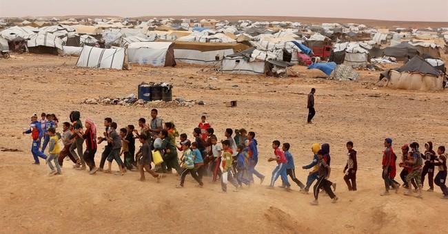 Some 59,000 Syrians, a new high, stranded  on Jordan border