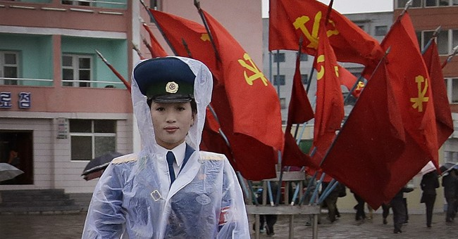 Image of Asia: Directing traffic on a North Korean street