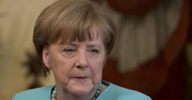The Latest: Merkel, Renzi see eye-to-eye on Africa aid