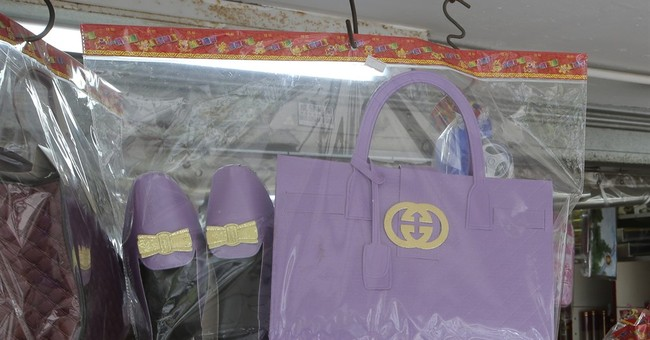 Gucci sorry for warning to Hong Kong funeral offering shops