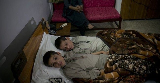 Pakistan treating 2 brothers who become paralyzed each night