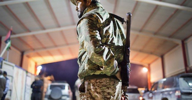 Rival assaults on IS stronghold deepen Libya's chaos