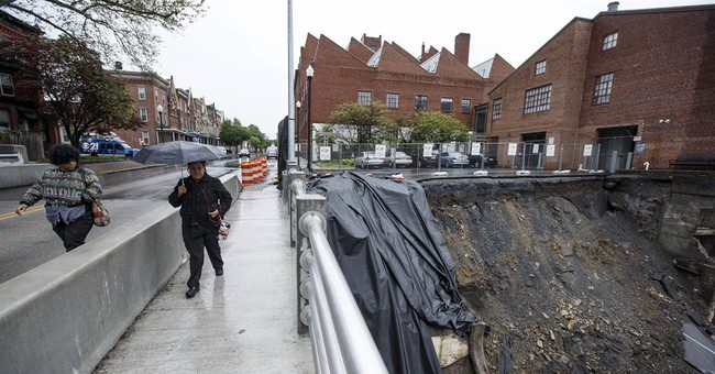 Bridge reopens a day after wall collapsed onto 2 businesses