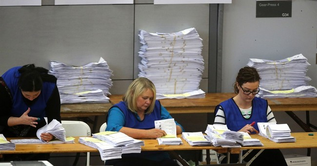 Democratic Unionists, Sinn Fein keep grip on N.Ireland power